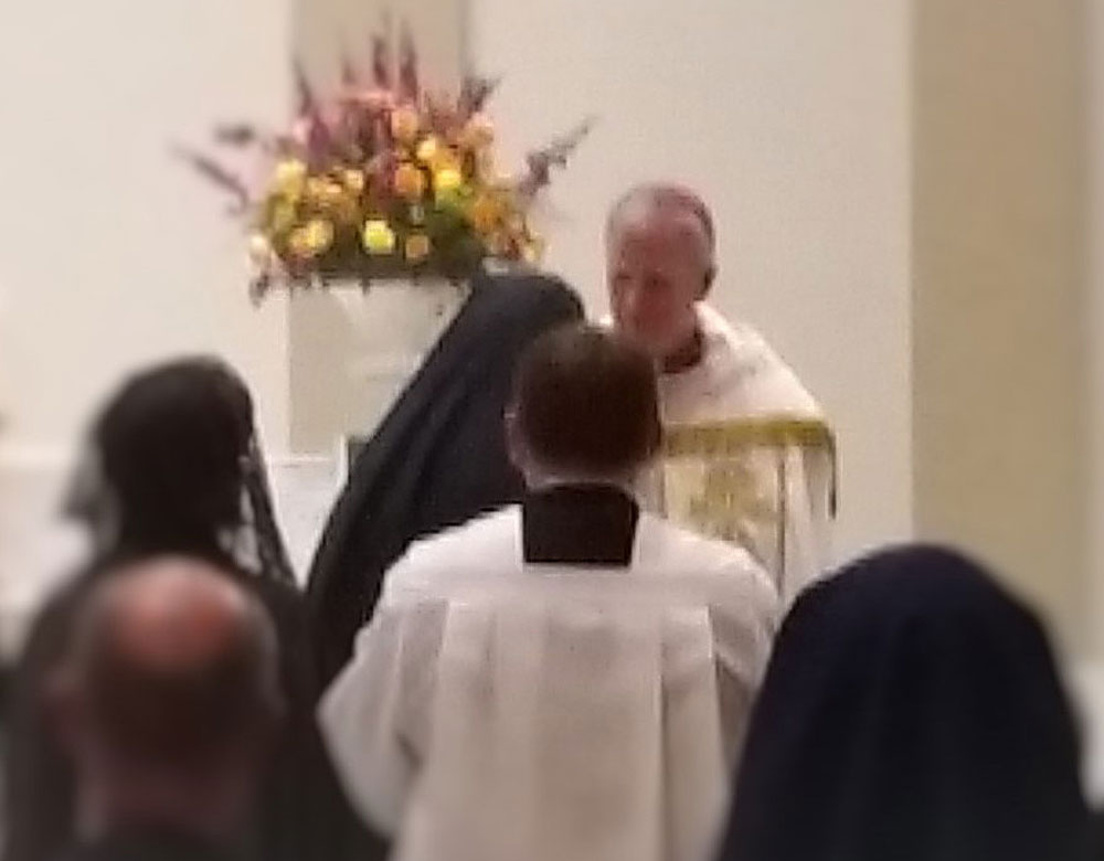 new Bishop James Johnston being greeted before Solemn Vespers by Mother Julia