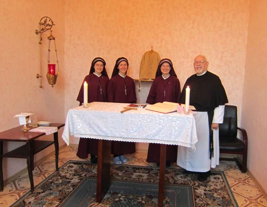 Sisters and priest in new chapel