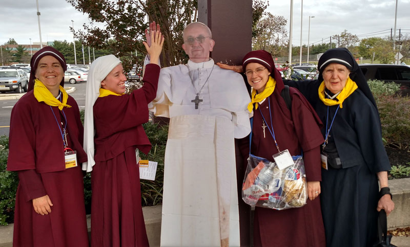 Sisters with cardboard statue of Pope Francis