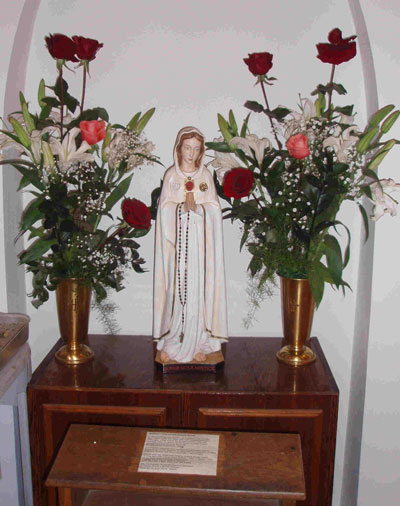 statue of Blessed Mother with roses